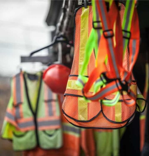 Orange and yellow vests and PPE