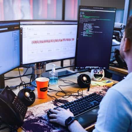 Man looking at computer screens