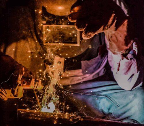 Man in PPE welding